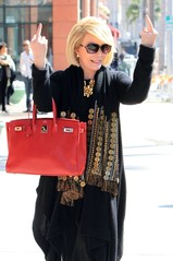 Joan river gives middle finger.jpg
