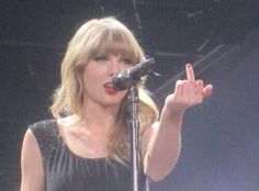 Taylor swift gives middle finger.jpg